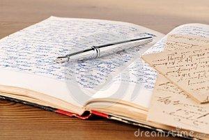diary-opened-pen-letter-40397032